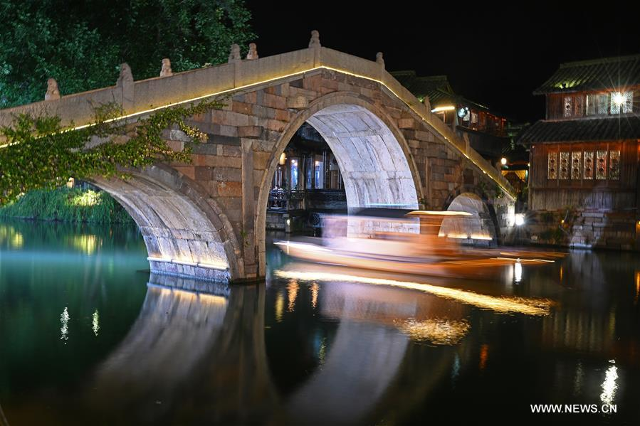 Photo taken on Nov. 6, 2018 shows the night scenery of Wuzhen, east China's Zhejiang Province. The fifth World Internet Conference (WIC) is scheduled to run from November 7-9 in the river town of Wuzhen. (Xinhua/Chen Yehua)<br/>