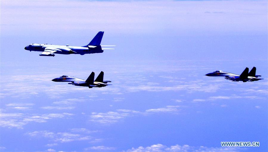 Chinese air force formation including H-6K bombers conduct island patrol in April 19, 2018. The Chinese Air Force announced a roadmap for building a stronger modern air force in three steps. The building of a stronger modern air force is in line with the overall goal of building national defense and the armed forces, Lieutenant General Xu Anxiang, deputy commander of Chinese Air Force, said at a press conference on celebrating the 69th anniversary of the establishment of Chinese Air Force held in Zhuhai, south China's Guangdong Province, Nov. 11, 2018. (Xinhua/Zhai Peisong)<br/>