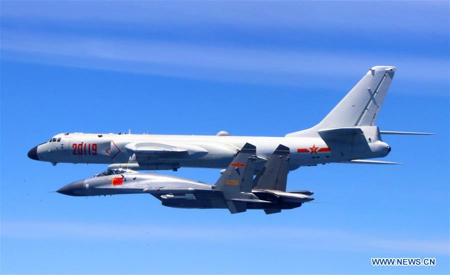 A Chinese People's Liberation Army (PLA) air force formation conducts island patrols during training on April 26, 2018. The Chinese Air Force announced a roadmap for building a stronger modern air force in three steps. The building of a stronger modern air force is in line with the overall goal of building national defense and the armed forces, Lieutenant General Xu Anxiang, deputy commander of Chinese Air Force, said at a press conference on celebrating the 69th anniversary of the establishment of Chinese Air Force held in Zhuhai, south China's Guangdong Province, Nov. 11, 2018. (Xinhua/Wu Yuepeng)<br/>