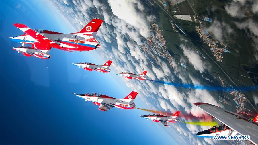 Red Falcon Air Demonstration Team performs during an activity of opening day at the Aviation University of Air Forces in Changchun, capital of northeast China's Jilin Province, Aug. 30, 2018. The Chinese Air Force announced a roadmap for building a stronger modern air force in three steps. The building of a stronger modern air force is in line with the overall goal of building national defense and the armed forces, Lieutenant General Xu Anxiang, deputy commander of Chinese Air Force, said at a press conference on celebrating the 69th anniversary of the establishment of Chinese Air Force held in Zhuhai, south China's Guangdong Province, Nov. 11, 2018. (Xinhua/Yang Pan)