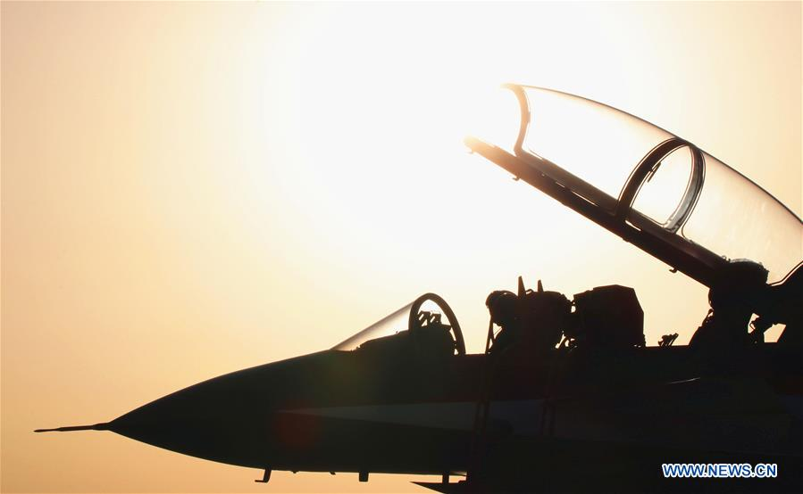 A J-10 fighter jet of the Chinese People's Liberation Army (PLA) Air Force's August 1st aerobatics team is seen at an airport in northwest China's Xinjiang Uygur Autonomous Region, Aug. 16, 2018. The Chinese Air Force announced a roadmap for building a stronger modern air force in three steps. The building of a stronger modern air force is in line with the overall goal of building national defense and the armed forces, Lieutenant General Xu Anxiang, deputy commander of Chinese Air Force, said at a press conference on celebrating the 69th anniversary of the establishment of Chinese Air Force held in Zhuhai, south China's Guangdong Province, Nov. 11, 2018. (Xinhua/Yu Yongde)<br/>