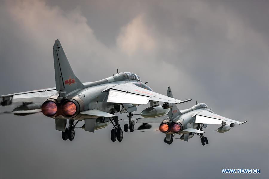 Two People's Liberation Army (PLA) airforce JH-7A fighter-bombers are seen during a training module in preparation for the International Army Games on July 12, 2018. The Chinese Air Force announced a roadmap for building a stronger modern air force in three steps. The building of a stronger modern air force is in line with the overall goal of building national defense and the armed forces, Lieutenant General Xu Anxiang, deputy commander of Chinese Air Force, said at a press conference on celebrating the 69th anniversary of the establishment of Chinese Air Force held in Zhuhai, south China's Guangdong Province, Nov. 11, 2018. (Xinhua/Yang Pan)<br/>
