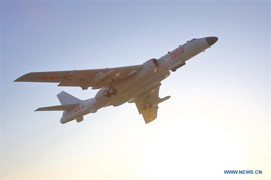 A Chinese air force plane takes off to conduct drills in international airspace over the Sea of Japan, Dec. 18, 2017. The Chinese Air Force announced a roadmap for building a stronger modern air force in three steps. The building of a stronger modern air force is in line with the overall goal of building national defense and the armed forces, Lieutenant General Xu Anxiang, deputy commander of Chinese Air Force, said at a press conference on celebrating the 69th anniversary of the establishment of Chinese Air Force held in Zhuhai, south China's Guangdong Province, Nov. 11, 2018. (Xinhua/Zhang Haishen)<br/>