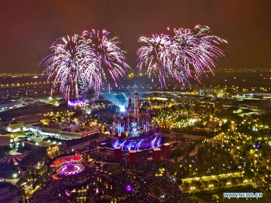 Photo taken on June 4, 2016 shows the night scene of Shanghai Disney Resort in Shanghai, east China. China is slated to become world's largest theme park market by 2020, when the number of tourists is expected to exceed 230 million, according to a fresh report by U.S. engineering firm AECOM. The number of tourists to Chinese theme parks have seen an average annual growth of 13 percent in the past decade, and reached 190 million in 2017. The number is expected to keep the double digit growth in the following years, according to the report. The report attributes the rapid growth to Chinese consumers' rising income that sparks greater demands on leisure activities, as well as more convenient public transportation systems. (Xinhua/Niu Yixin)<br/>
