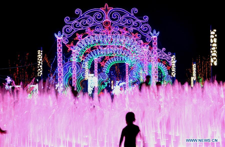 Tourists enjoy colorful lights during a light art festival held at a space theme park in Yanjiao of Sanhe City, north China's Hebei Province, July 29, 2016. China is slated to become world's largest theme park market by 2020, when the number of tourists is expected to exceed 230 million, according to a fresh report by U.S. engineering firm AECOM. The number of tourists to Chinese theme parks have seen an average annual growth of 13 percent in the past decade, and reached 190 million in 2017. The number is expected to keep the double digit growth in the following years, according to the report. The report attributes the rapid growth to Chinese consumers' rising income that sparks greater demands on leisure activities, as well as more convenient public transportation systems. (Xinhua/Li Mingfang)<br/>