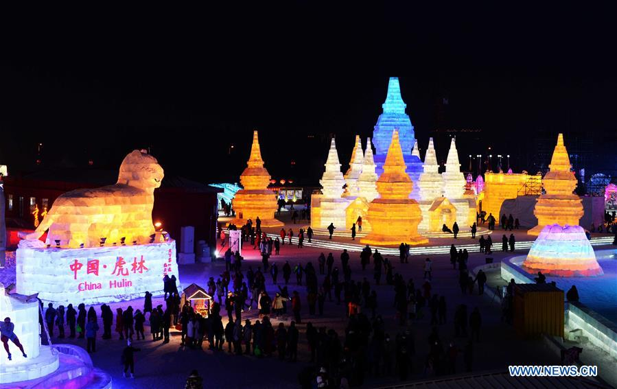 Tourists visit Harbin Ice and Snow World, northeast China's Heilongjiang Province, Jan. 5, 2017. China is slated to become world's largest theme park market by 2020, when the number of tourists is expected to exceed 230 million, according to a fresh report by U.S. engineering firm AECOM. The number of tourists to Chinese theme parks have seen an average annual growth of 13 percent in the past decade, and reached 190 million in 2017. The number is expected to keep the double digit growth in the following years, according to the report. The report attributes the rapid growth to Chinese consumers' rising income that sparks greater demands on leisure activities, as well as more convenient public transportation systems. (Xinhua/Wang Kai)<br/>