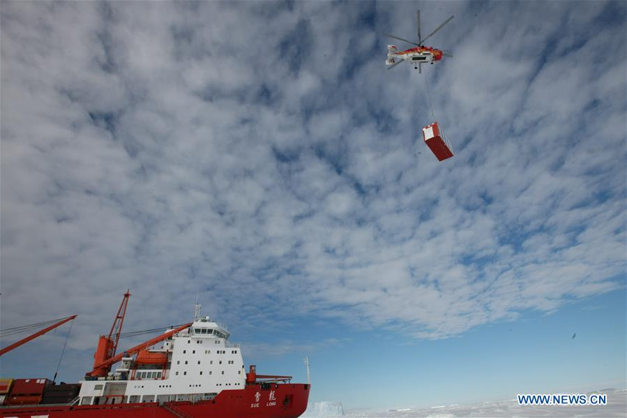Members of the research team use the helicopter to unload cargo at the roadstead off the Zhongshan station in Antarctica, Dec. 1, 2018. China's research icebreaker Xuelong arrived at the roadstead off the Zhongshan station in Antarctica on Saturday. Unloading work has been carried out. Xuelong carrying a research team set sail from Shanghai on Nov. 2, beginning the country's 35th Antarctic expedition. (Xinhua/Liu Shiping)