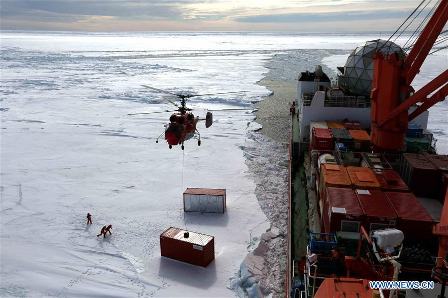 Members of the research team use the helicopter to unload cargo at the roadstead off the Zhongshan station in Antarctica, Dec. 1, 2018. China's research icebreaker Xuelong arrived at the roadstead off the Zhongshan station in Antarctica on Saturday. Unloading work has been carried out. Xuelong carrying a research team set sail from Shanghai on Nov. 2, beginning the country's 35th Antarctic expedition. (Xinhua/Liu Shiping)<br/>
