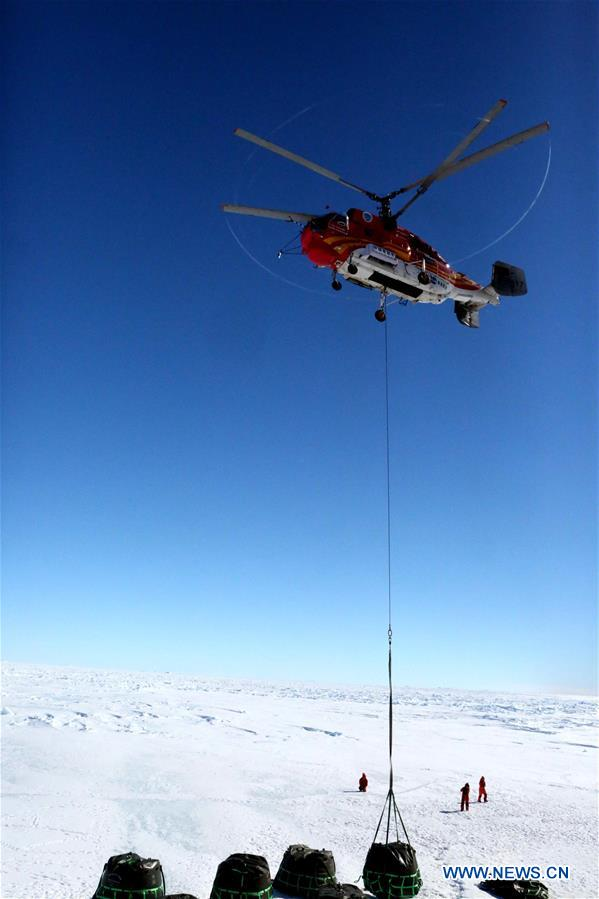 A helicopter of China's research icebreaker Xuelong lifts supplies in Antarctica, Dec. 3, 2018. China's research icebreaker Xuelong, also known as the Snow Dragon, is now 44 kilometers away from the Zhongshan station. Unloading operations have been carried out after the routes were determined. (Xinhua/Liu Shiping)<br/>