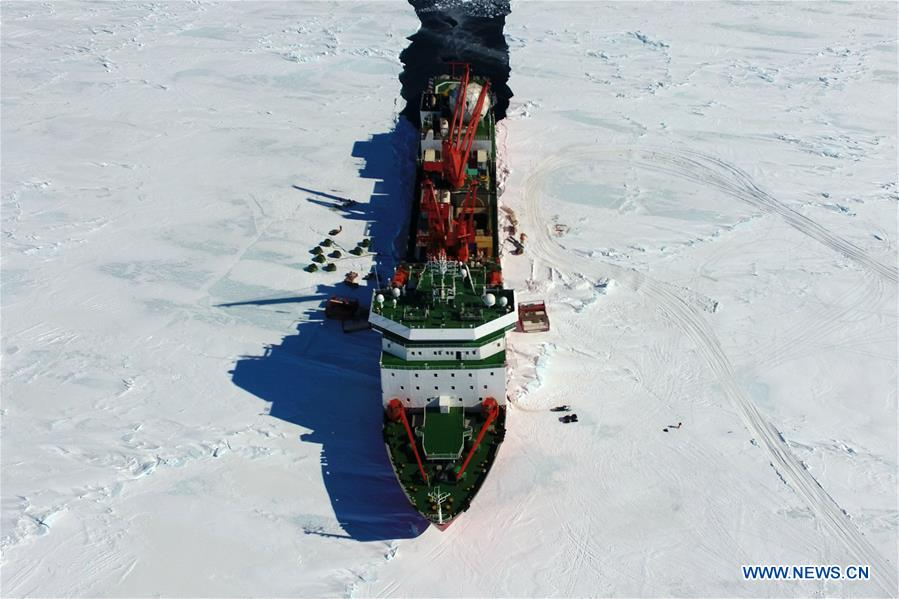 Aerial photo taken on Dec. 3, 2018 shows China's research icebreaker Xuelong in Antarctica. China's research icebreaker Xuelong, also known as the Snow Dragon, is now 44 kilometers away from the Zhongshan station. Unloading operations have been carried out after the routes were determined. (Xinhua/Liu Shiping)<br/>