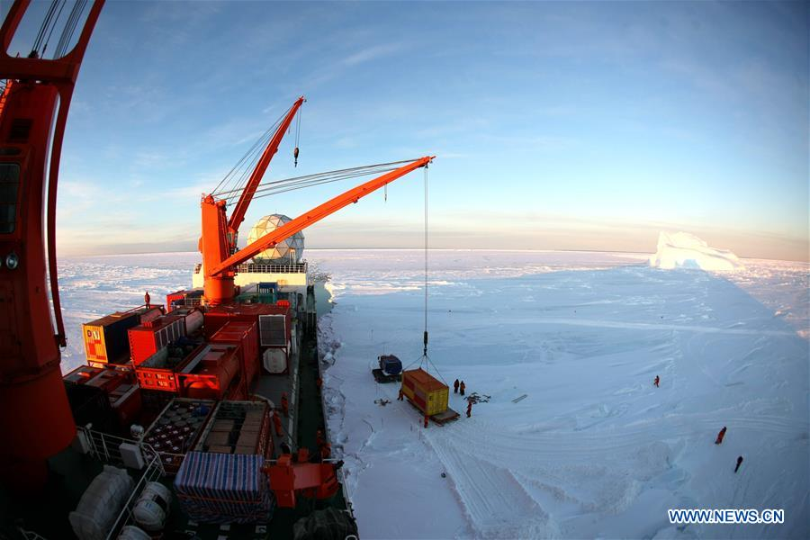 A crane unloads a container of supplies from China's research icebreaker Xuelong in Antarctica, Dec. 2, 2018. China's research icebreaker Xuelong, also known as the Snow Dragon, is now 44 kilometers away from the Zhongshan station. Unloading operations have been carried out after the routes were determined. (Xinhua/Liu Shiping)<br/>