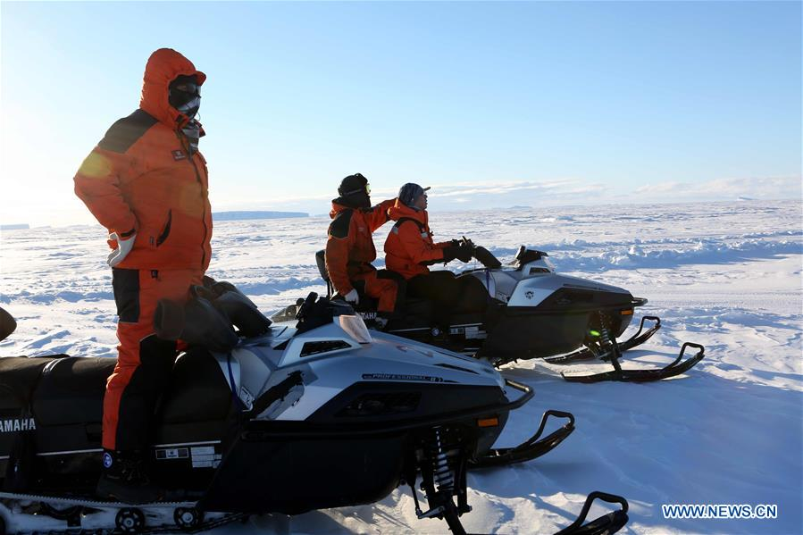 Staff members of the research team drive snowmobiles to detect routes on ice in Antarctica, Nov. 30, 2018. China's research icebreaker Xuelong, also known as the Snow Dragon, is now 44 kilometers away from the Zhongshan station. Unloading operations have been carried out after the routes were determined. (Xinhua/Liu Shiping)<br/>