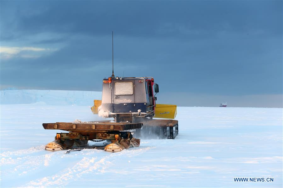 Staff members of China's research icebreaker Xuelong drive snowmobile to detect routes on ice in Antarctica, Nov. 30, 2018. China's research icebreaker Xuelong, also known as the Snow Dragon, is now 44 kilometers away from the Zhongshan station. Unloading operations have been carried out after the routes were determined. (Xinhua/Liu Shiping)