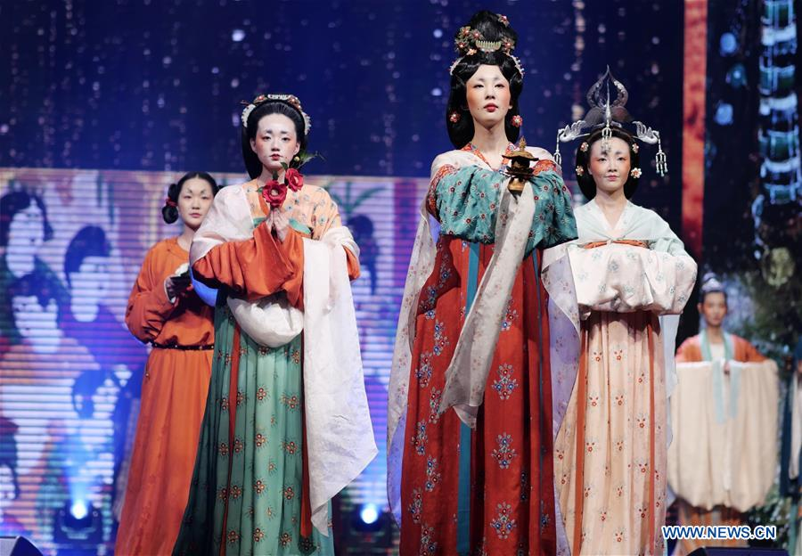 Models present costumes during a performance for tourism promotion by northwest China's Gansu Province, in Hong Kong, south China, Dec. 4, 2018. (Xinhua/Wang Shen)<br/>