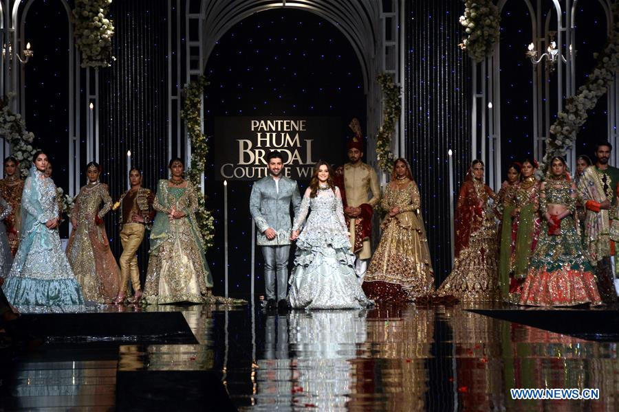 Models present creations by designer Aosadya on the second day of Bridal Couture Week in eastern Pakistan's Lahore on Dec. 8, 2018. (Xinhua/Sajjad)<br/>