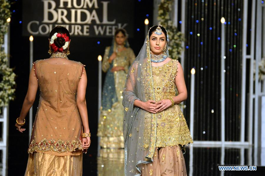 A model presents a creation by designer Aisha Sadiya on the second day of Bridal Couture Week in eastern Pakistan's Lahore on Dec. 8, 2018. (Xinhua/Jamil Ahmed)