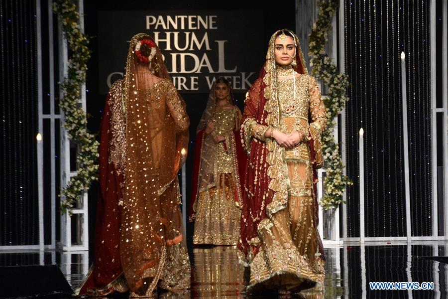 Models present creations by designer Faika Karim on the second day of Bridal Couture Week in eastern Pakistan's Lahore on Dec. 8, 2018. (Xinhua/Sajjad)<br/>