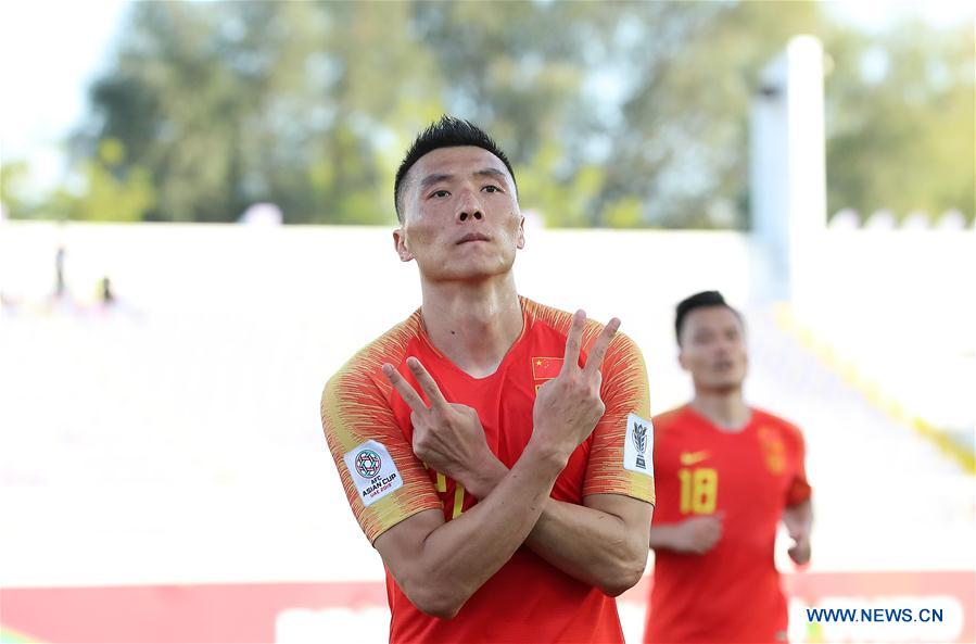 Yu Dabao (front) of China celebrates scoring during the group C match between China and Kyrgyz Republic of the AFC Asian Cup UAE 2019 in Al Ain, the United Arab Emirates (UAE), on Jan. 7, 2019. (Xinhua/Cao Can)<br/>