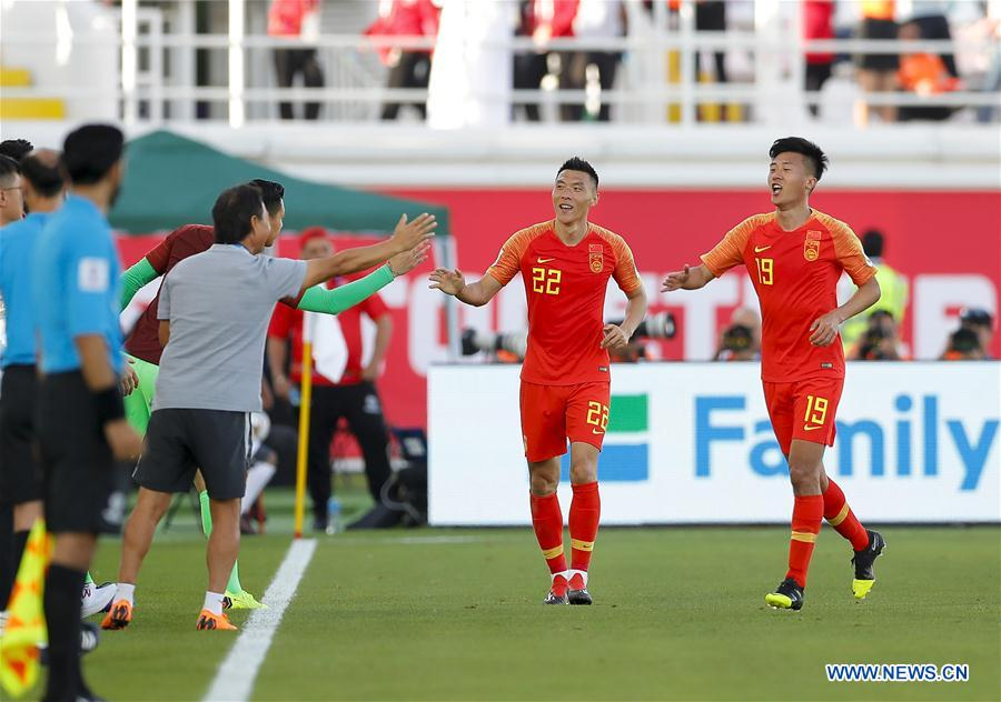 Yu Dabao (2nd R) of China celebrates scoring during the group C match between China and Kyrgyz Republic of the AFC Asian Cup UAE 2019 in Al Ain, the United Arab Emirates (UAE), on Jan. 7, 2019. China won 2-1. (Xinhua/Ding Xu)<br/>