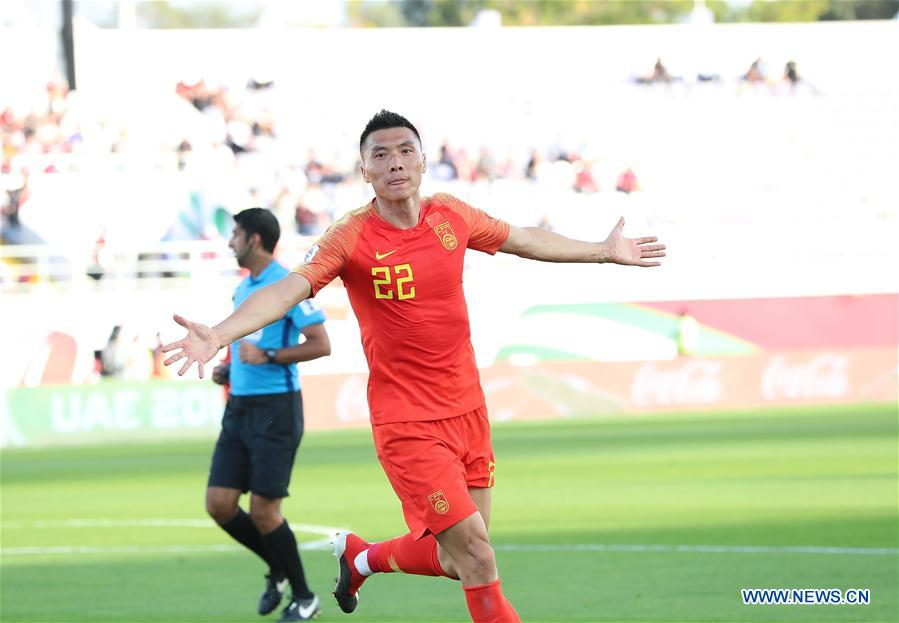 Yu Dabao (front) of China celebrates scoring during the group C match between China and Kyrgyz Republic of the AFC Asian Cup UAE 2019 in Al Ain, the United Arab Emirates (UAE), on Jan. 7, 2019. China won 2-1. (Xinhua/Cao Can)<br/>