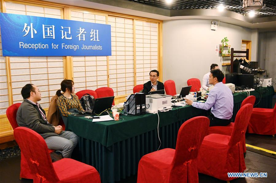 Staff work at the press center for the second session of the 13th NPC and the second session of the 13th CPPCC National Committee in Beijing, capital of China, Feb. 27, 2019. The press center was put into official use on Wednesday. The 13th National People's Congress (NPC), China's national legislature, will start its second annual session on March 5 and the 13th National Committee of the Chinese People's Political Consultative Conference (CPPCC), the country's national political advisory body, will begin its second annual session on March 3. (Xinhua/Chen Yehua)<br/>
