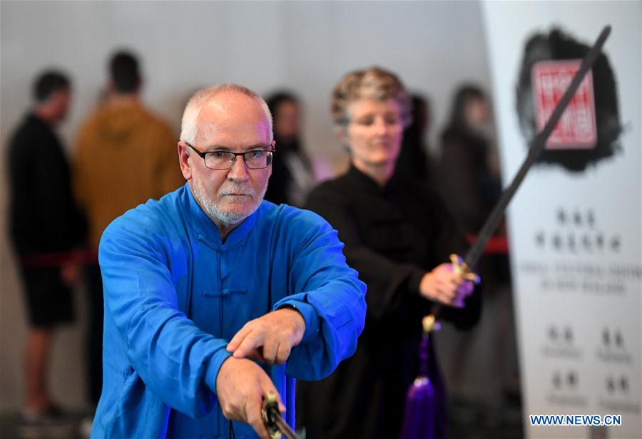 A local Taichi enthusiast practices Taichi sword during the Chinese Community Stage Festival at Museum of New Zealand in Wellington, New Zealand, March 9, 2019. The Museum of New Zealand held the Chinese Community Stage Festival event on Saturday to celebrate the 2019 China-New Zealand Year of Tourism. (Xinhua/Guo Lei)