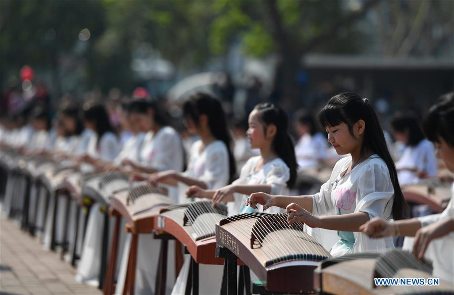 Performers play Guzheng, a Chinese zither-like string music instrument, during the launching ceremony of the 37th China Luoyang Peony Cultural Festival in Luoyang, central China's Henan Province, April 1, 2019. The 37th China Luoyang Peony Cultural Festival was launched Monday at the China National Flower Garden in Luoyang. During the festival, peony species under artificial flowering time regulation have reached their full blooming, while other species left to flower naturally have also begun to bloom. (Xinhua/Li Jianan)