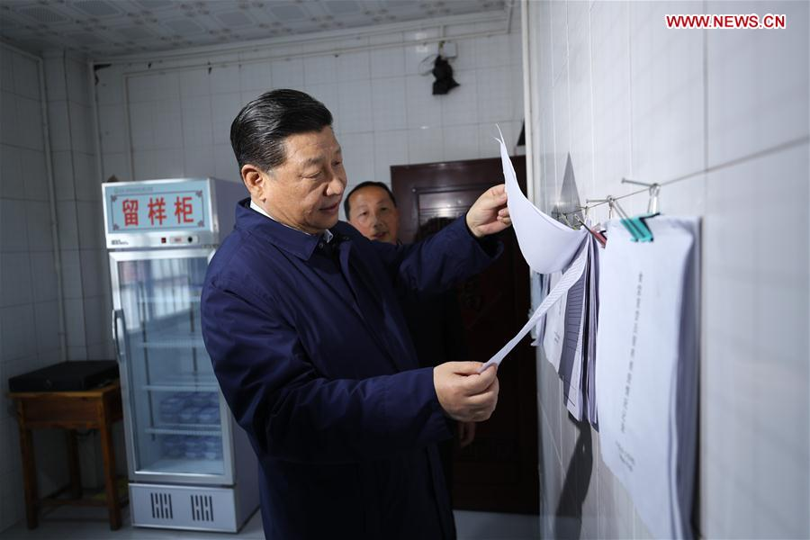 Chinese President Xi Jinping, also general secretary of the Communist Party of China Central Committee and chairman of the Central Military Commission, learns about a mechanism requiring school officials to dine with students at a primary school in Zhongyi Township of Shizhu Tujia Autonomous County, southwest China's Chongqing, April 15, 2019. Xi went on an inspection tour in southwest China's Chongqing Municipality Monday. (Xinhua/Ju Peng)<br/>