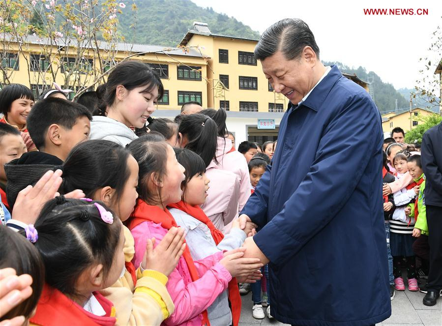 Chinese President Xi Jinping, also general secretary of the Communist Party of China Central Committee and chairman of the Central Military Commission, talks with students at a primary school in Zhongyi Township of Shizhu Tujia Autonomous County, southwest China's Chongqing, April 15, 2019. Xi went on an inspection tour in southwest China's Chongqing Municipality Monday. (Xinhua/Xie Huanchi)<br/>