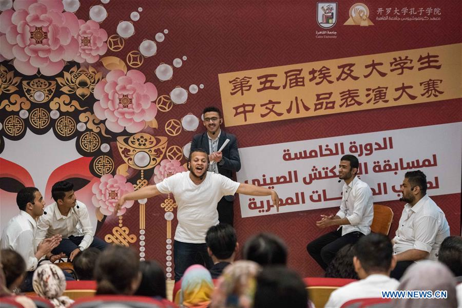Students perform during the Chinese-Language Comedy Competition for Egyptian College Students in Cairo, Egypt, on April 18, 2019. The 5th Chinese-Language Comedy Competition for Egyptian College Students was held on Thursday in the Confucius Institute Theater of Cairo University. (Xinhua/Wu Huiwo)<br/>