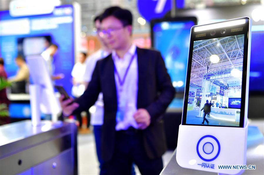 An exhibitor shows a face-detection entrance guard system at the 2nd Digital China Exhibition in Fuzhou, southeast China's Fujian Province, May 5, 2019. The 2nd Digital China Exhibition runs from May 5 to 9 at the Fuzhou Strait International Conference & Exhibition Center. (Xinhua/Wei Peiquan)