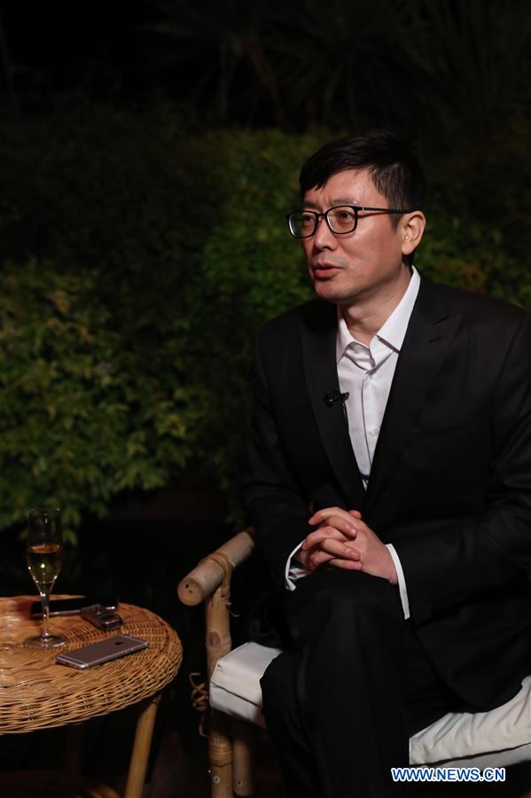 """Director Diao Yinan of the film """"Wild Goose Lake"""" receives an interview with Xinhua at the 72nd Cannes Film Festival in Cannes, France, May 18, 2019. Chinese director Diao Yinan's film """"Wild Goose Lake"""" will compete for the Palme d'Or with other 20 feature films during the 72nd Cannes Film Festival which is held from May 14 to 25. (Xinhua/Zhang Cheng)"""