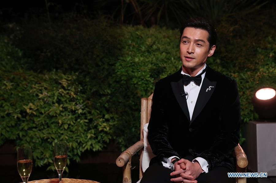 "Actor Hu Ge from the film ""Wild Goose Lake"" receives an interview with Xinhua at the 72nd Cannes Film Festival in Cannes, France, May 18, 2019. Chinese director Diao Yinan's film ""Wild Goose Lake"" will compete for the Palme d'Or with other 20 feature films during the 72nd Cannes Film Festival which is held from May 14 to 25. (Xinhua/Zhang Cheng)<br/>"