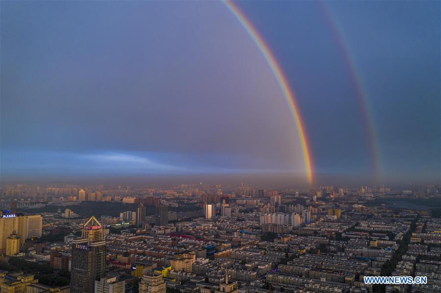 <br/> Aerial photo shows double rainbow arching across Changchun City, northeast China's Jilin Province, on June 11, 2019. A double rainbow brightened the sky over Changchun City after a strong rainfall hit the city. (Xinhua/Xu Chang)<br/>