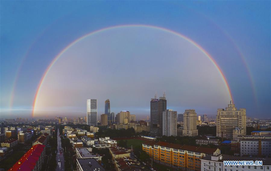 <br/> Stitched aerial photo taken on June 11, 2019 shows double rainbow arching across Changchun City, northeast China's Jilin Province. A double rainbow brightened the sky over Changchun City after a strong rainfall hit the city. (Xinhua/Xu Chang)<br/>