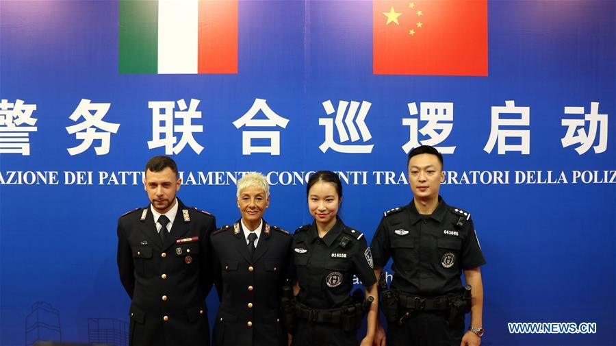 Chinese and Italian police officers pose for a group photo during the launching ceremony of the joint patrol between Chinese and Italian police held in Guangzhou, capital of south China's Guangdong Province, June 26, 2019. Italian police officers on Monday began patrolling tourist sites in China, with their local counterparts, after a launching ceremony held in Beijing. The joint patrol, the third such exercise between Chinese and Italian police in China, will last until July 5 in four cities: Beijing, Shanghai, Chongqing and Guangzhou. (Xinhua/Huang Guobao)<br/>