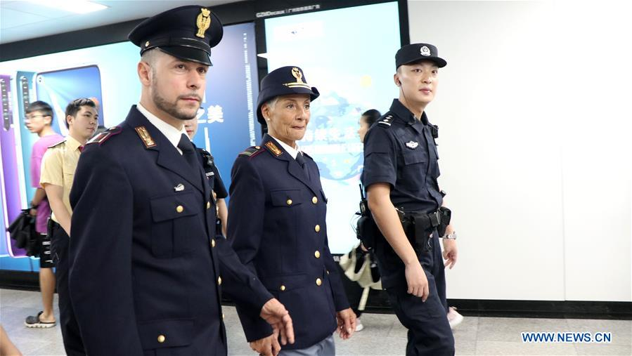 Chinese and Italian police officers patrol a metro station in Guangzhou, capital of south China's Guangdong Province, June 26, 2019. Italian police officers on Monday began patrolling tourist sites in China, with their local counterparts, after a launching ceremony held in Beijing. The joint patrol, the third such exercise between Chinese and Italian police in China, will last until July 5 in four cities: Beijing, Shanghai, Chongqing and Guangzhou. (Xinhua/Huang Guobao)