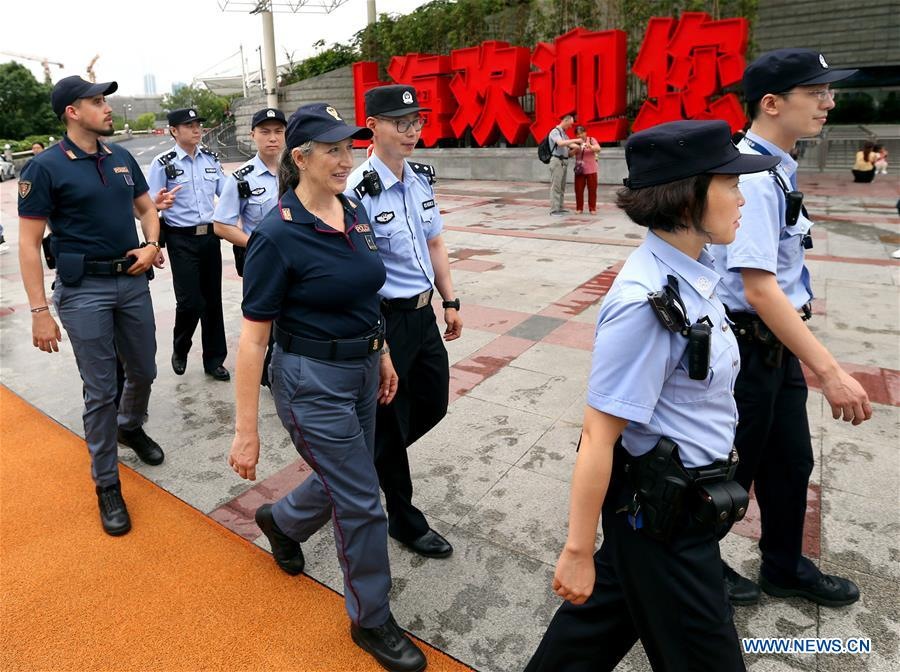 Chinese and Italian police officers patrol under the Oriental Pearl Tower in east China's Shanghai, June 26, 2019. Italian police officers on Monday began patrolling tourist sites in China, with their local counterparts, after a launching ceremony held in Beijing. The joint patrol, the third such exercise between Chinese and Italian police in China, will last until July 5 in four cities: Beijing, Shanghai, Chongqing and Guangzhou. (Xinhua/Fan Jun)<br/>