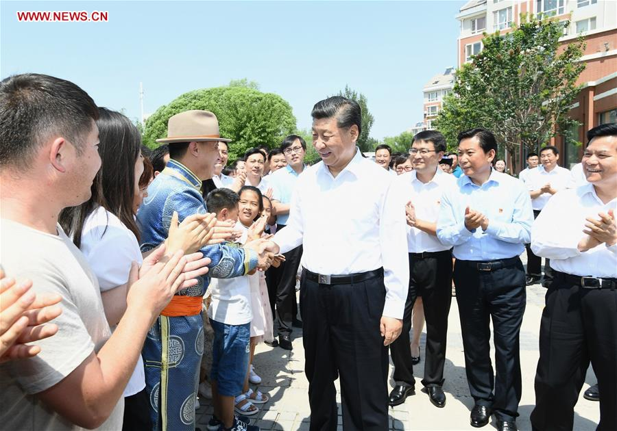 Chinese President Xi Jinping, also general secretary of the Communist Party of China (CPC) Central Committee and chairman of the Central Military Commission, shakes hands with residents of a community at Songshan District in Chifeng City, China's Inner Mongolia Autonomous Region, July 15, 2019. Xi went on an inspection tour in Inner Mongolia Monday. (Xinhua/Xie Huanchi)<br/>Xi Jinping, general secretary of the Communist Party of China Central Committee, went on an inspection tour in north China's Inner Mongolia Autonomous Region Monday.<br/>