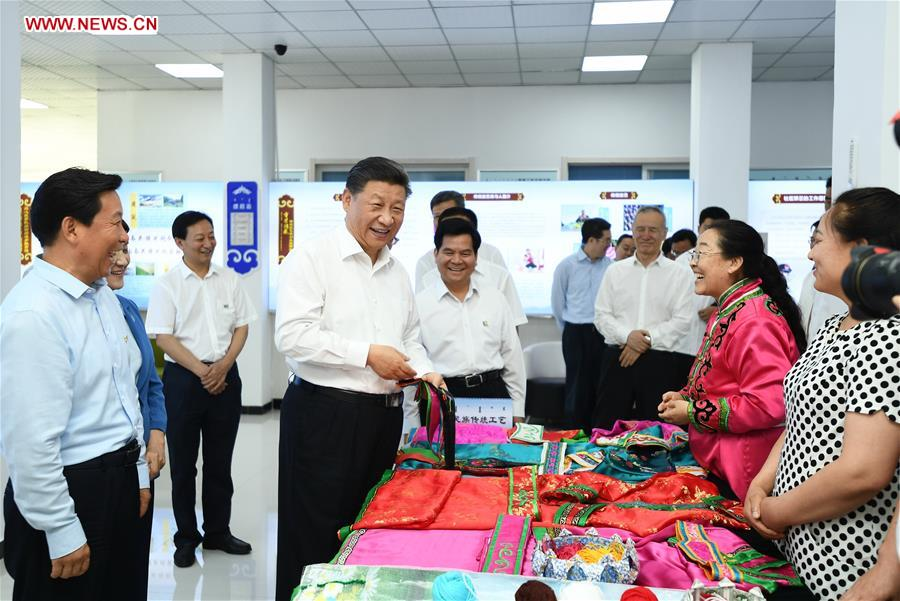 Chinese President Xi Jinping, also general secretary of the Communist Party of China (CPC) Central Committee and chairman of the Central Military Commission, visits a community at Songshan District in Chifeng City, China's Inner Mongolia Autonomous Region, July 15, 2019. Xi went on an inspection tour in Inner Mongolia Monday. (Xinhua/Xie Huanchi)<br/>