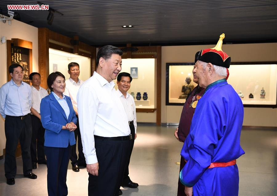 Chinese President Xi Jinping, also general secretary of the Communist Party of China (CPC) Central Committee and chairman of the Central Military Commission, talks with intangible cultural heritage inheritors to the King Gesar epic at Chifeng Museum in Chifeng City, China's Inner Mongolia Autonomous Region, July 15, 2019. Xi went on an inspection tour in Inner Mongolia Monday. (Xinhua/Xie Huanchi)<br/>