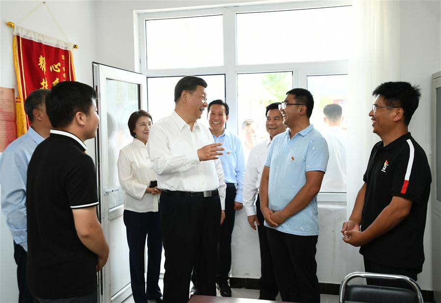 Chinese President Xi Jinping, also general secretary of the Communist Party of China (CPC) Central Committee and chairman of the Central Military Commission, visits Maanshan Village in Harqin Qi of Chifeng City, China's Inner Mongolia Autonomous Region, July 15, 2019. Xi went on an inspection tour in Inner Mongolia Monday. (Xinhua/Xie Huanchi)