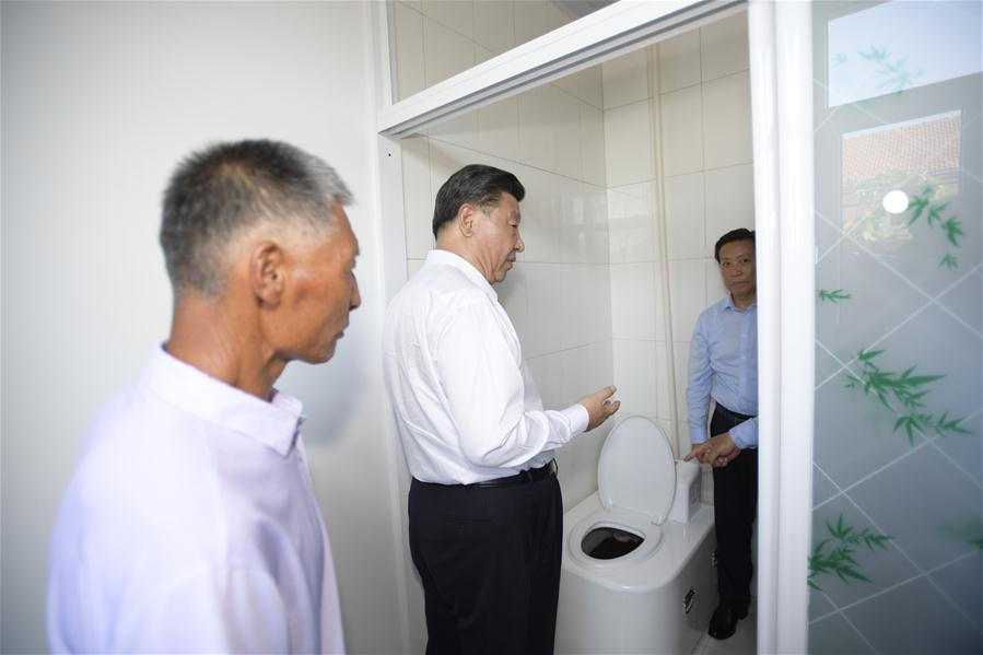 Chinese President Xi Jinping, also general secretary of the Communist Party of China (CPC) Central Committee and chairman of the Central Military Commission, visits Maanshan Village in Harqin Qi of Chifeng City, China's Inner Mongolia Autonomous Region, July 15, 2019. Xi went on an inspection tour in Inner Mongolia Monday. (Xinhua/Li Xueren)<br/>