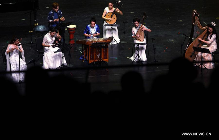 """<br/> Musicians perform at a traditional Chinese music concert themed on """"Lofty Mountains and Flowing Water"""" held as a part of the first Tsingtao International Music Festival in Qingdao, east China's Shandong Province, Aug. 4, 2019. (Xinhua/Li Ziheng)<br/>"""