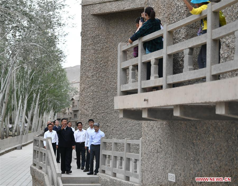 Chinese President Xi Jinping, also general secretary of the Communist Party of China (CPC) Central Committee and chairman of the Central Military Commission, visits the Mogao Grottoes in Dunhuang, a key cultural heritage site under state-level protection, during his inspection tour of northwest China's Gansu Province, Aug. 19, 2019. Xi inspected the work of cultural relics protection and study, as well as efforts to promote China's great history and fine culture. (Xinhua/Xie Huanchi)<br/>Xi Jinping, general secretary of the Communist Party of China Central Committee, on Monday visited the Mogao Grottoes in Dunhuang, a key cultural heritage site under state-level protection, during his inspection tour of northwest China's Gansu Province.<br/>Xi inspected the work of cultural relics protection and study, as well as efforts to promote China's great history and fine culture.<br/>