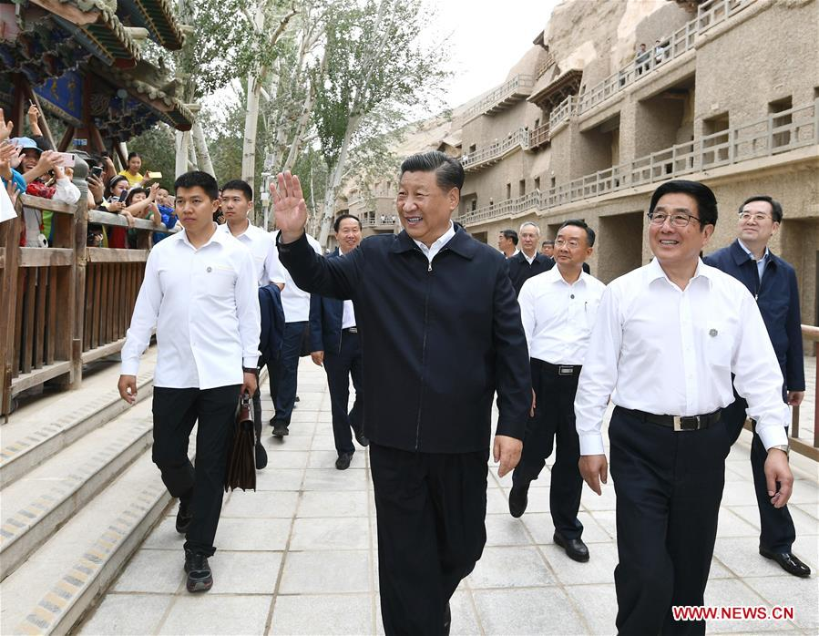 Chinese President Xi Jinping, also general secretary of the Communist Party of China (CPC) Central Committee and chairman of the Central Military Commission, visits the Mogao Grottoes in Dunhuang, a key cultural heritage site under state-level protection, during his inspection tour of northwest China's Gansu Province, Aug. 19, 2019. Xi inspected the work of cultural relics protection and study, as well as efforts to promote China's great history and fine culture. (Xinhua/Xie Huanchi)<br/>