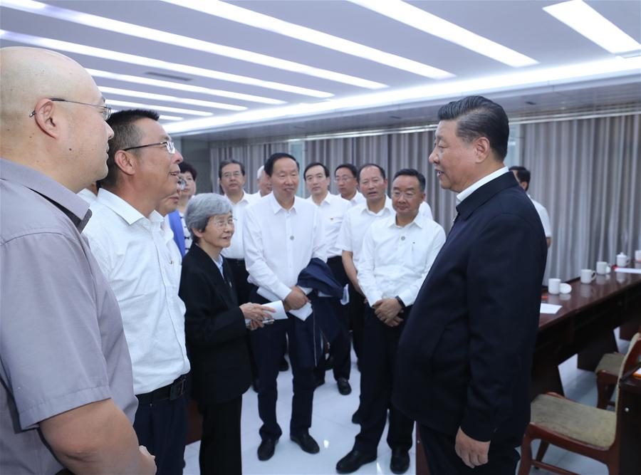 Chinese President Xi Jinping, also general secretary of the Communist Party of China (CPC) Central Committee and chairman of the Central Military Commission, visited exhibitions of relics and research results and attended a symposium with experts, scholars and representatives from cultural units in the Dunhuang Academy in Dunhuang during his inspection tour of northwest China's Gansu Province, Aug. 19, 2019. (Xinhua/Ju Peng)<br/>