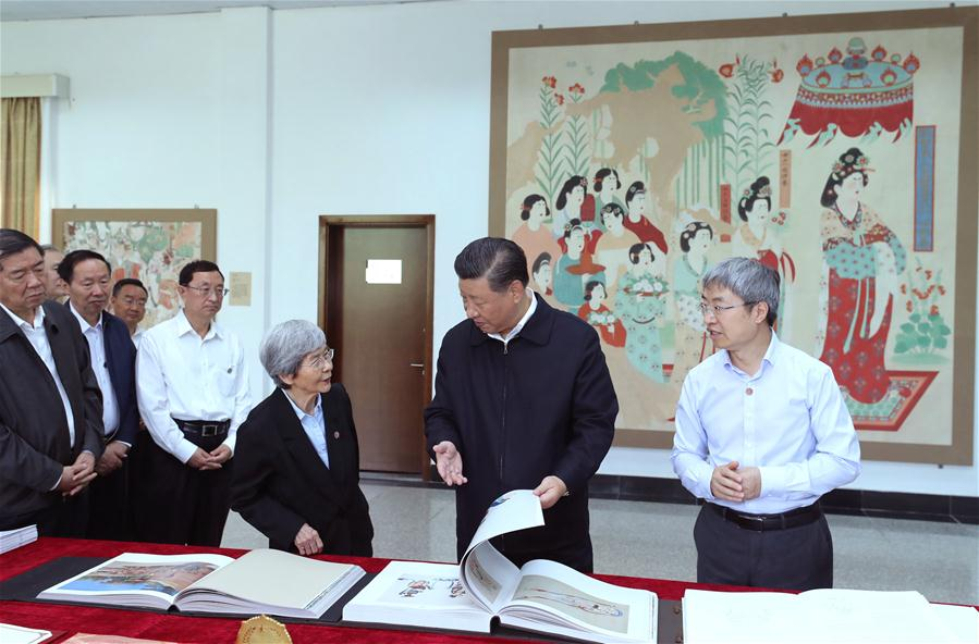 Chinese President Xi Jinping, also general secretary of the Communist Party of China (CPC) Central Committee and chairman of the Central Military Commission, visited exhibitions of relics and research results and attended a symposium with experts, scholars and representatives from cultural units in the Dunhuang Academy in Dunhuang during his inspection tour of northwest China's Gansu Province, Aug. 19, 2019. (Xinhua/Ju Peng)