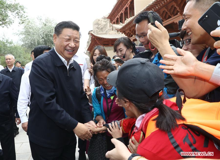 Chinese President Xi Jinping, also general secretary of the Communist Party of China (CPC) Central Committee and chairman of the Central Military Commission, visits the Mogao Grottoes in Dunhuang, a key cultural heritage site under state-level protection, during his inspection tour of northwest China's Gansu Province, Aug. 19, 2019. Xi inspected the work of cultural relics protection and study, as well as efforts to promote China's great history and fine culture. (Xinhua/Ju Peng)<br/>