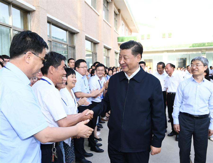 Chinese President Xi Jinping, also general secretary of the Communist Party of China (CPC) Central Committee and chairman of the Central Military Commission, visited exhibitions of relics and research results and attended a symposium with experts, scholars and representatives from cultural units in the Dunhuang Academy in Dunhuang during his inspection tour of northwest China's Gansu Province, Aug. 19, 2019. (Xinhua/Xie Huanchi)<br/>